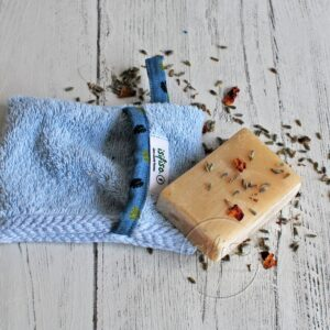 Light blue soap mitt with contrast fabric trim flat lay