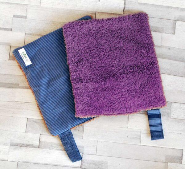 Blue striped kitchen towel Two open each flipped purple towel