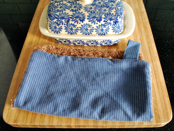 Reusable paper towels in blue stripes on a chopping board