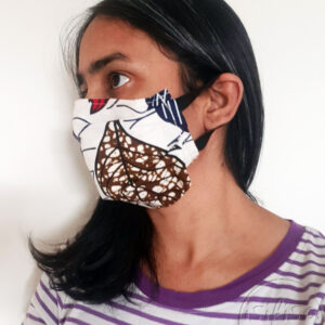 Washable face mask Cream leaves printed masks triple layer mask with nose wire and elasticated on a model side view