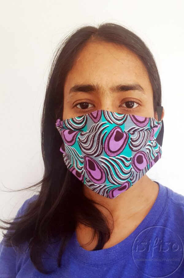 Turquoise, purple and brown shapes printed masks triple layer mask with nose wire and elasticated on a model front expanded