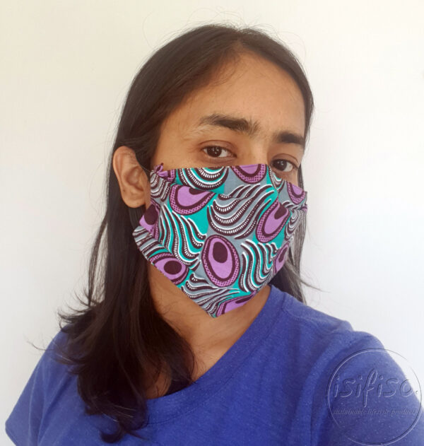 Turquoise and purple peacock printed masks triple layer mask with nose wire and elasticated on a model side view