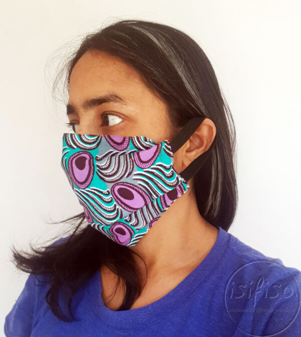 Turquoise and purple geo shapes printed masks triple layer mask with nose wire and elasticated on a model side view
