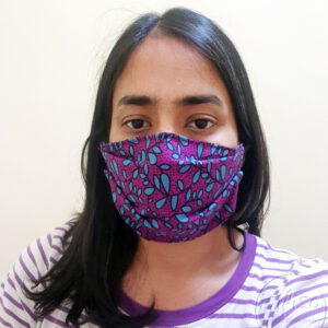 Turquoise and purple leaves printed masks triple layer mask with nose wire and on a model front view expanded