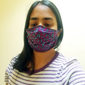 Turquoise and purple leaves printed masks triple layer mask with nose wire and elasticated on a model front view