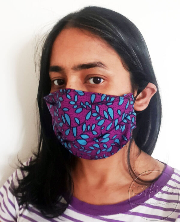 Turquoise and purple leaves printed masks triple layer mask with nose wire and elasticated on a model expanded