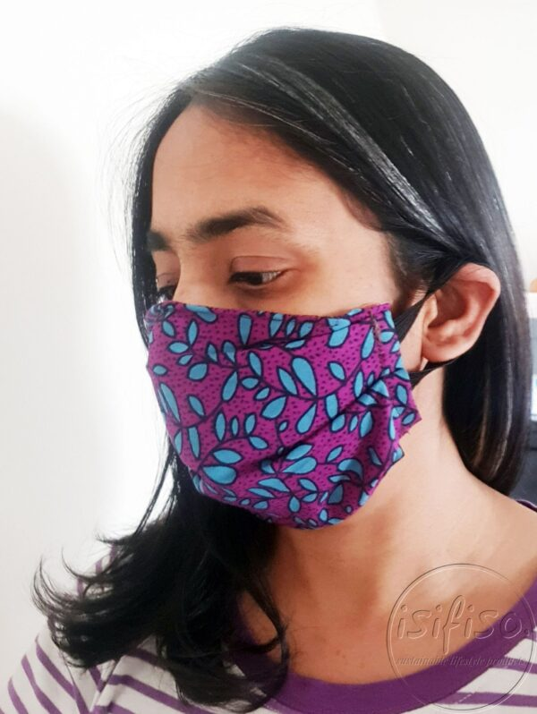 Turquoise and purple leaves printed masks triple layer mask with nose wire and elasticated on a model side view