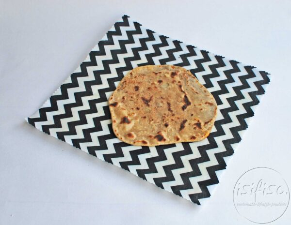 Black chevron beeswax wrap displayed with bread (food)