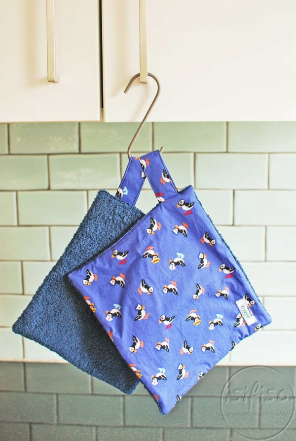 Toucan print home wipes with navy blue towelling hanging to dry