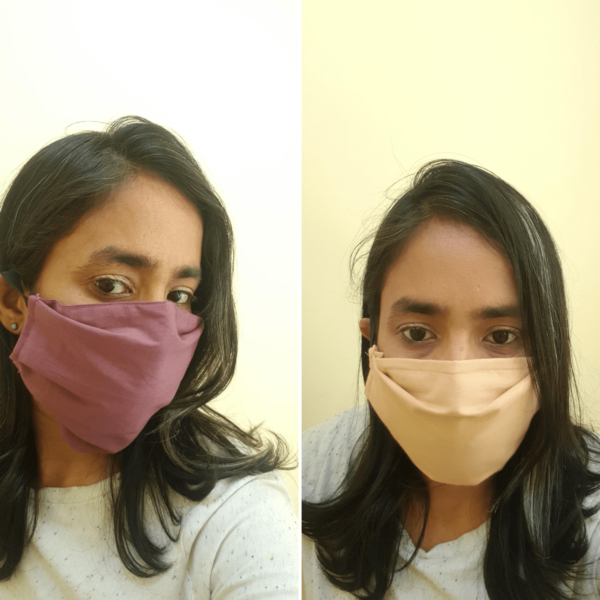 Purple and Beige coloured masks triple layer mask with nose wire and elasticated on a model