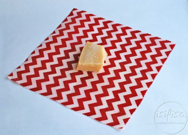 Red chevrons printed Beeswax wrap displayed with cheese (food)