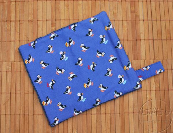 Toucan print wipe flat-lay