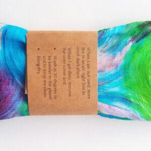 Blue swirl print yoga eye pillow packaged back