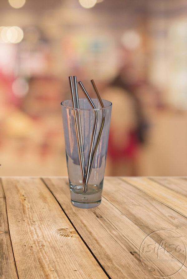 Metal straws empty tumbler bokeh background