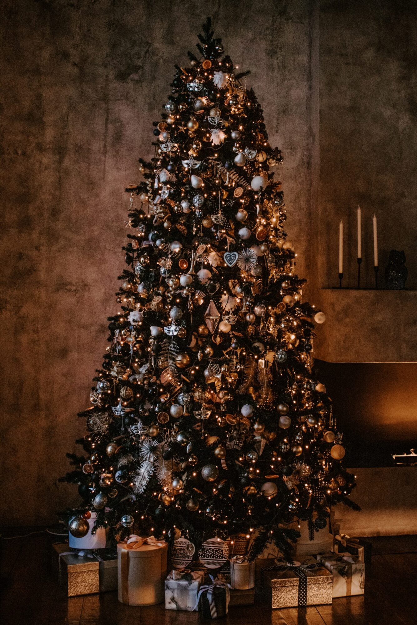 Fully decorated Christmas tree on a dark background