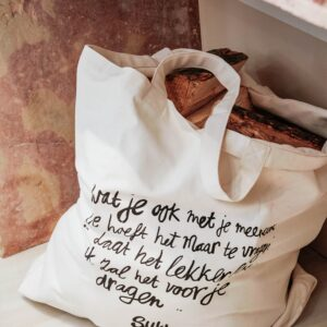 reusable cloth bag in cream with bread inside planet friendly bag