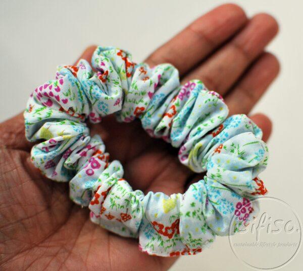 skinny handmade eco scrunchy ditsy multi color flowers printed on a hand