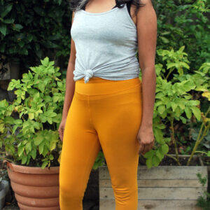 mustard yellow organic cotton legging on a model